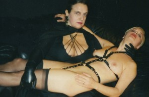 female-misbehaviour-1992-001-naked-woman-bondage-gear-caressed-by-woman-with-leather-gloves