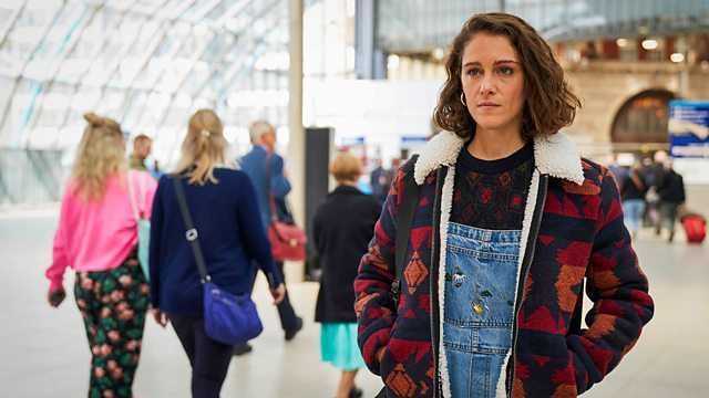 Ray (Ariane Labed) in transit and in dungarees.