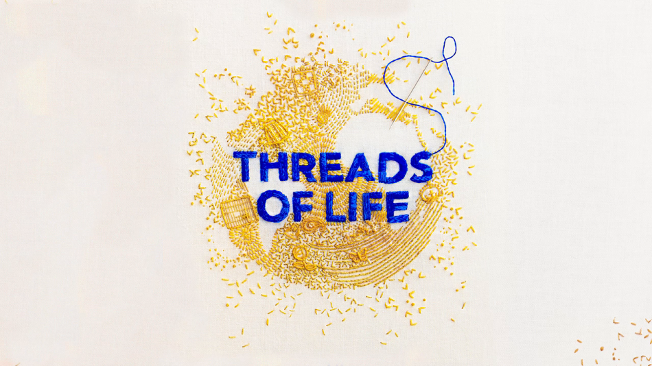 The image shows the cover of Clare Hunter's book Threads of Life, with the title stitched in royal blue on a background of golden stitches that resemble grain.