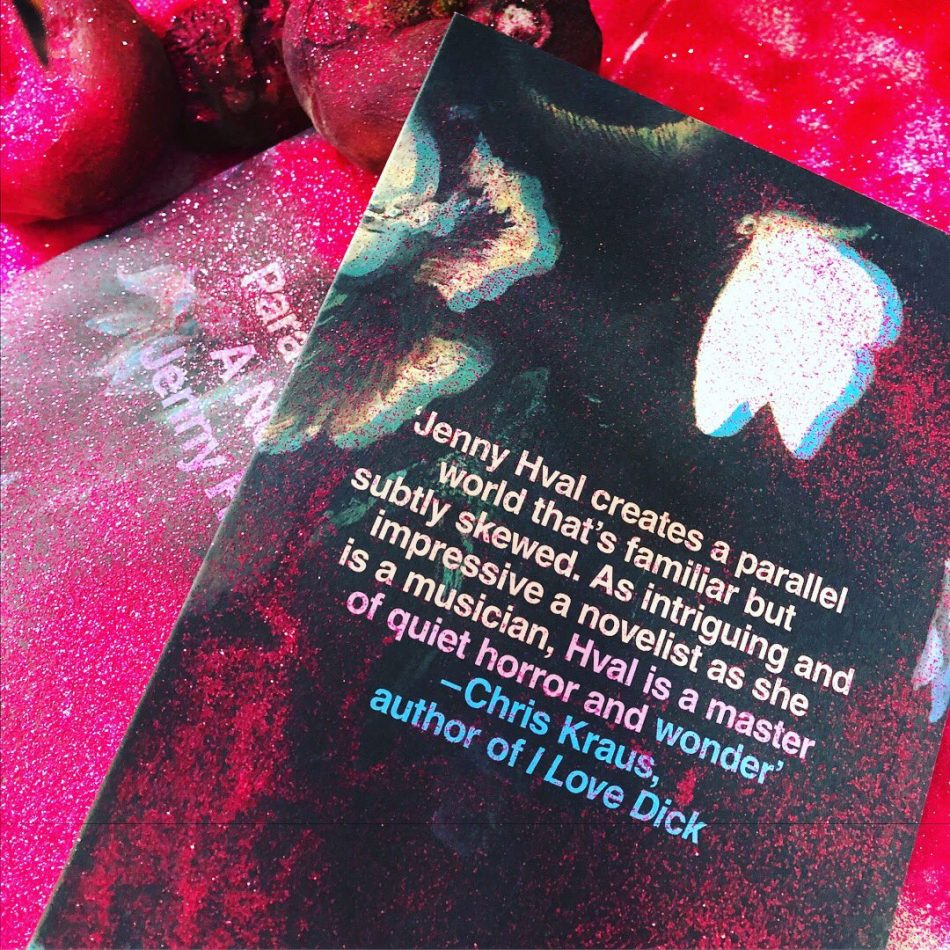 """The image shows the back cover of the book Paradise Rot. There is a pink filter over the image. The back cover features a white moth and pink print that looks like lichen. It has a blurb text that reads: """"Jenny Hval creates a parallel world that's familiar but subtly skewed. As intriguing and impressive a novelist as she is a musician, Hval is a master of quiet horror and wonder."""" The blurb is by Chris Kraus, author of I Love Dick. There is a second copy of the book face-upwards beneath the main copy, and some drooping pink tulips in the top left hand corner of the image."""