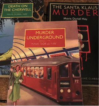 The image shows three books by Mavis Doriel Hay: Death on the Cherwell, whose cover shows a punt on the river under hanging trees; Murder Underground, which shows a white woman in a smart green suit on the platform next to a red London Underground tube; and The Santa Klaus Murder, which has a black cover with a red design.