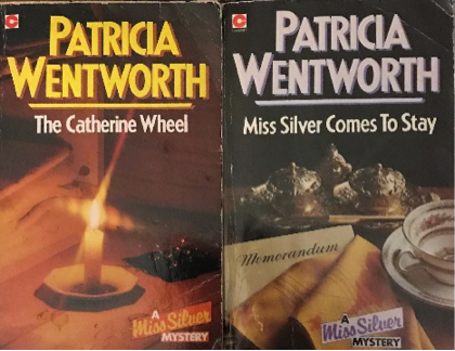 The image shows the covers of two books by Patricia Wentworth: The Catherine Wheel, which features a lit candle on a saucer, on a bedside table; and Miss Silver Comes to Stay, which features a tea cup and silver cruet set.