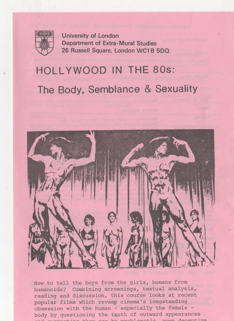 """The image is a flyer, printed on pink paper, for a course at University of London, Department of Extra-Mural Studies, titled Hollywood in the 80s: The Body, Semblance and Sexuality. The flyer features a still from Pumping Iron 2 featuring two of the competing women bodybuilders posing at the front of the stage. The start of the course description reads """"How to tell the boys from the girls, humans from humanoids? Combining screenings, textual analysis, reading and discussion, this course looks at recent popular films which revamp cinema's longstanding obsession with the human - especially the female - body by questioning the truth of outward appearances."""""""